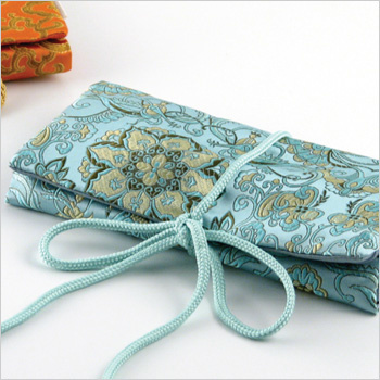monogrammed brocade jewelry roll with 3 zippered compartments