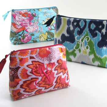 laminated print collection; cosmetic bags, jewelry rolls, and more
